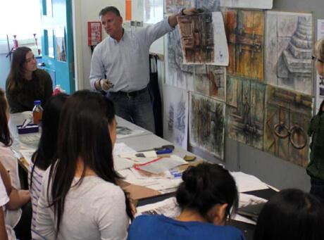 Students observing Ian Murphy's artworks