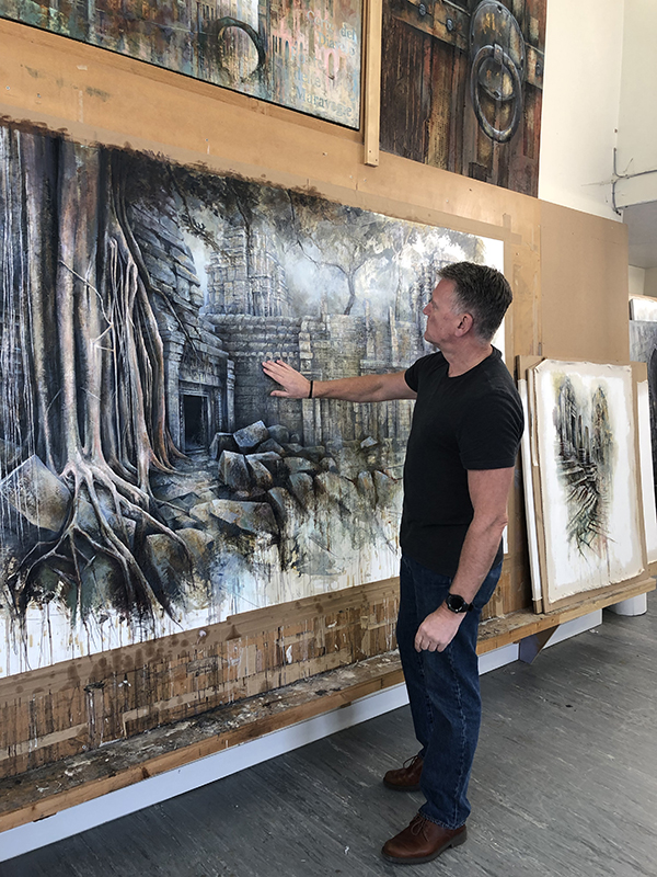 Ian Murphy showing some of his artworks